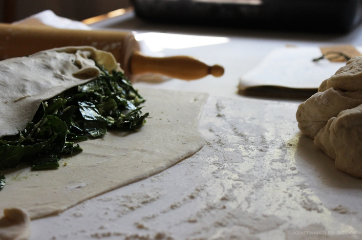 perfect rustic spinach pie - curn the pastry over the filling and roll